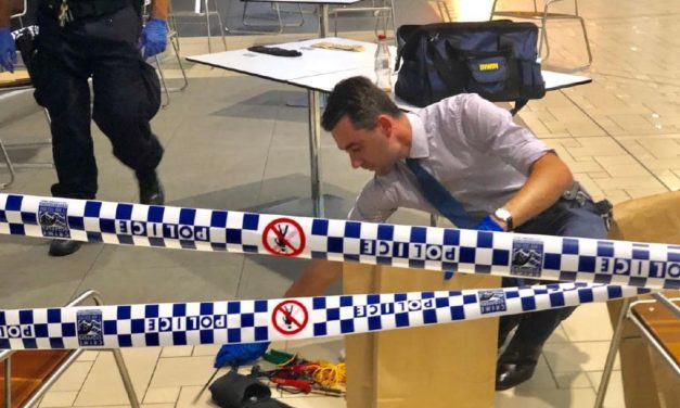 Brisbane Airport lockdown: Police shoot man in 'bomb threat'